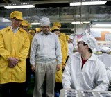 Apple CEO Tim Cook visiting a Foxconn supplier plant
