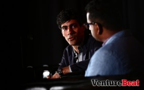 Yelp cofounder and CEO Jeremy Stoppelman talks onstage during the first day of MobileBeat 2013.