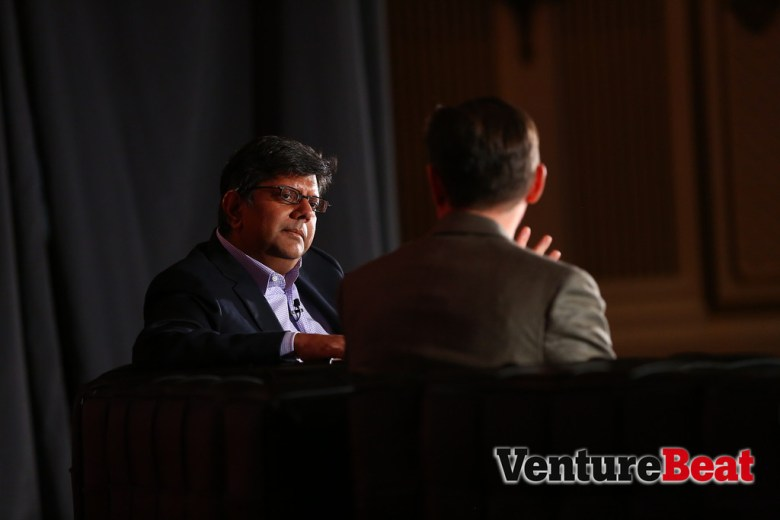 Qualcomm CMO Anand  Chandrasekher (left) during the first day of MobileBeat 2013.