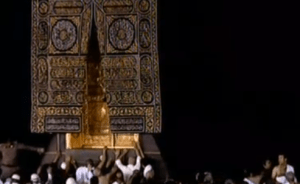 Worshippers reach up to touch the 300-kg solid gold doors