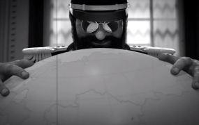 Tropico 5's El Presidente admires a globe.