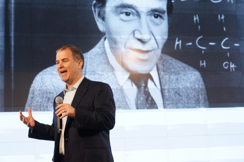 Kaplan CEO Andy Rosen, standing in front of a picture of Stanley Kaplan.