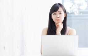 Befuddled student on computer