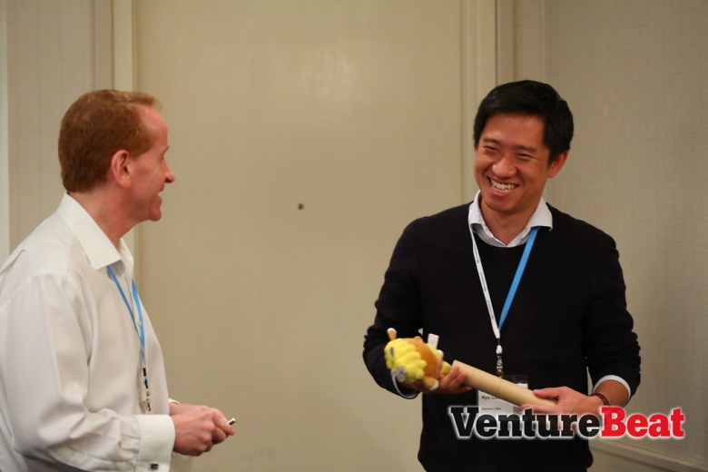 Moderator Tim Merel, the managing director of Digi-Capital, jokes with Gamevil USA president Kyu Lee (right) during GamesBeat 2013.