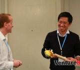 Moderator Tim Merel, the managing director of Digi-Capital, jokes with Gamevil USA president Kyu Lee (right) during GamesBeat 2013.
