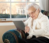 This grandma could make a logo on her tablet with DesignMantic's design tools