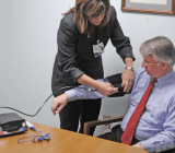 Transitional Care Manager Michele Sandock shows off a new telehealth unit