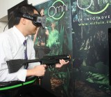 "GamesBeat editor-in-chief Dan ""Shoe"" Hsu trying  out Virtuix's Omni virtual-reality treadmill."