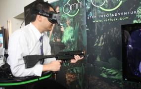 "GamesBeat editor-in-chief Dan ""Shoe"" Hsu trying  out Virtuix's Omni virtual-reality treadmill."