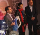 Andrew House gives the first PlayStation 4 to Joey Chiu, after he forks over $400.