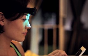 A woman wears an early prototype of the Aurora headband.