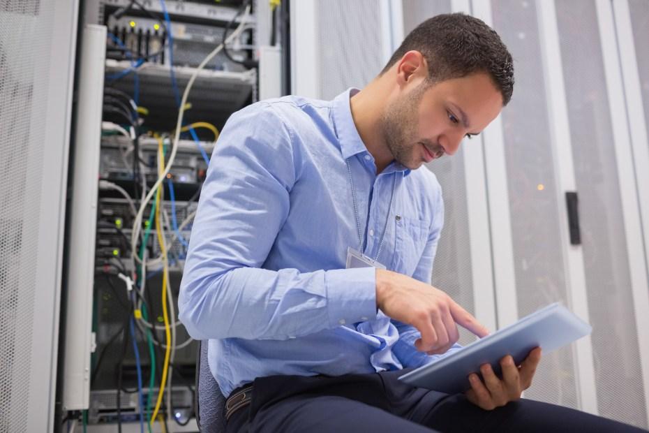 Man tablet servers data center wavebreakmedia shutterstock