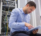 Man tablet servers data center wavebreakmedia shutterstock