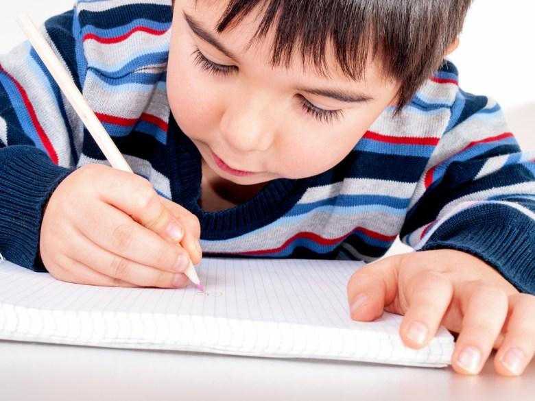 boy drawing luchschen shutterstock