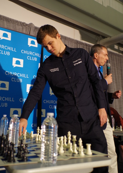 World chess champion Magnus Carlsen plays a game on Jan. 16 before a Churchill Club talk with Peter Thiel at the Computer History Museum in Mountain View, Calif.