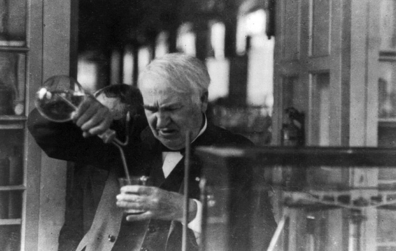 Thomas Edison experimenting in his laboratory.