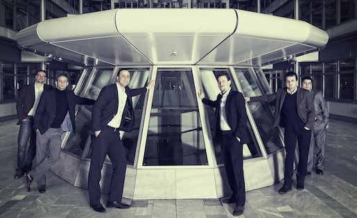 Companisto's founders next to a strange-looking structure.