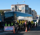"Protestors block a ""Google Bus"" in San Francisco."