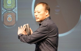 HTC CEO Peter Chou holding the new One smartphone
