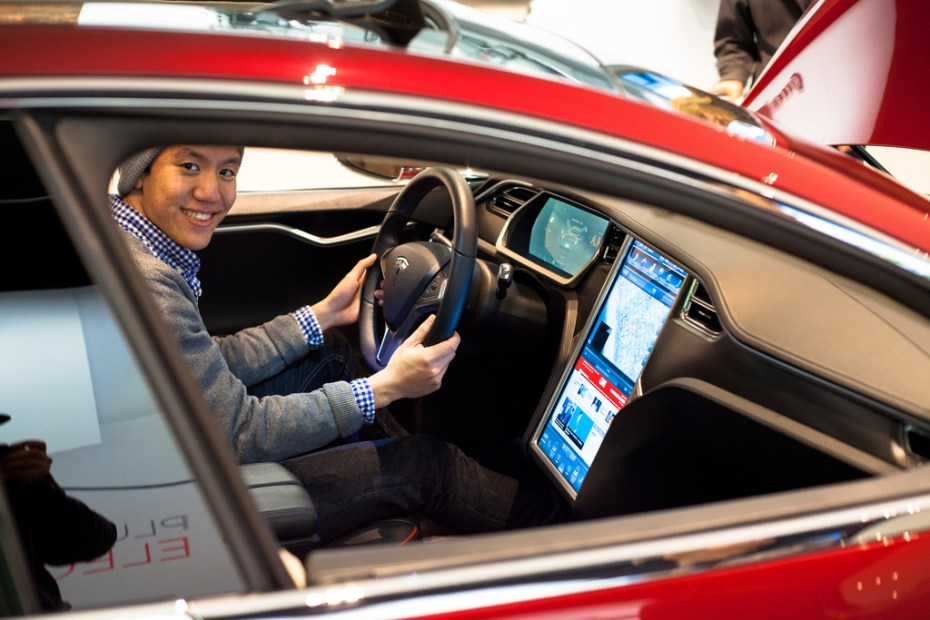Another happy-looking Tesla driver.
