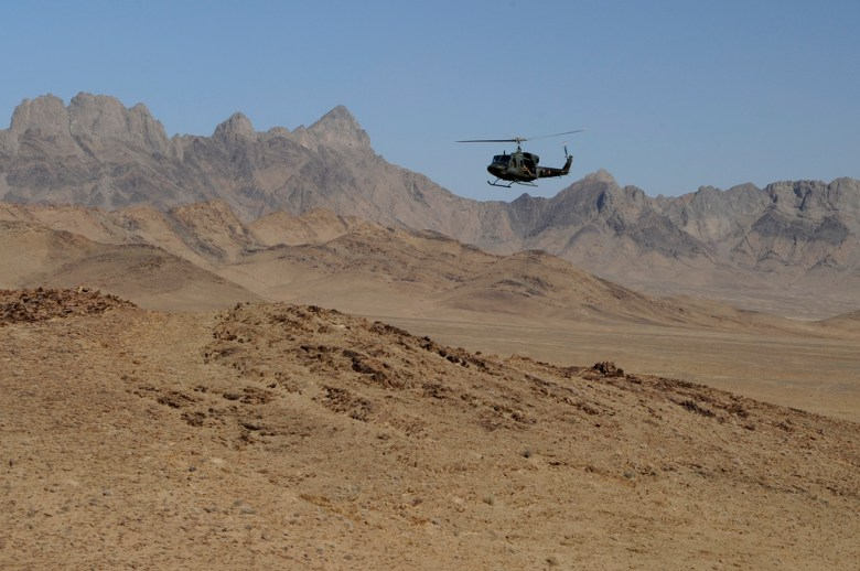 An Italian helicopter flies over western Afghanistan during an international operation. Lithium reserves have been found in the western part of that country.