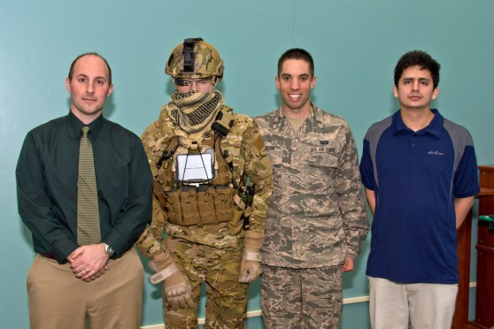 The Air Force's BATMAN team poses with their Google Glass-testing dummy. Left to right: Dr. Gregory Burnett, dummy, 2nd Lieutenant Anthony Eastin, and Andres Calvo.