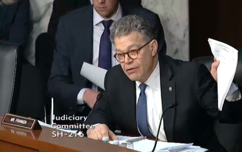 Senator Al Franken listens to earlier testimony of Comcast executives on the goodness of its proposed acquisition of Time Warner Cable.