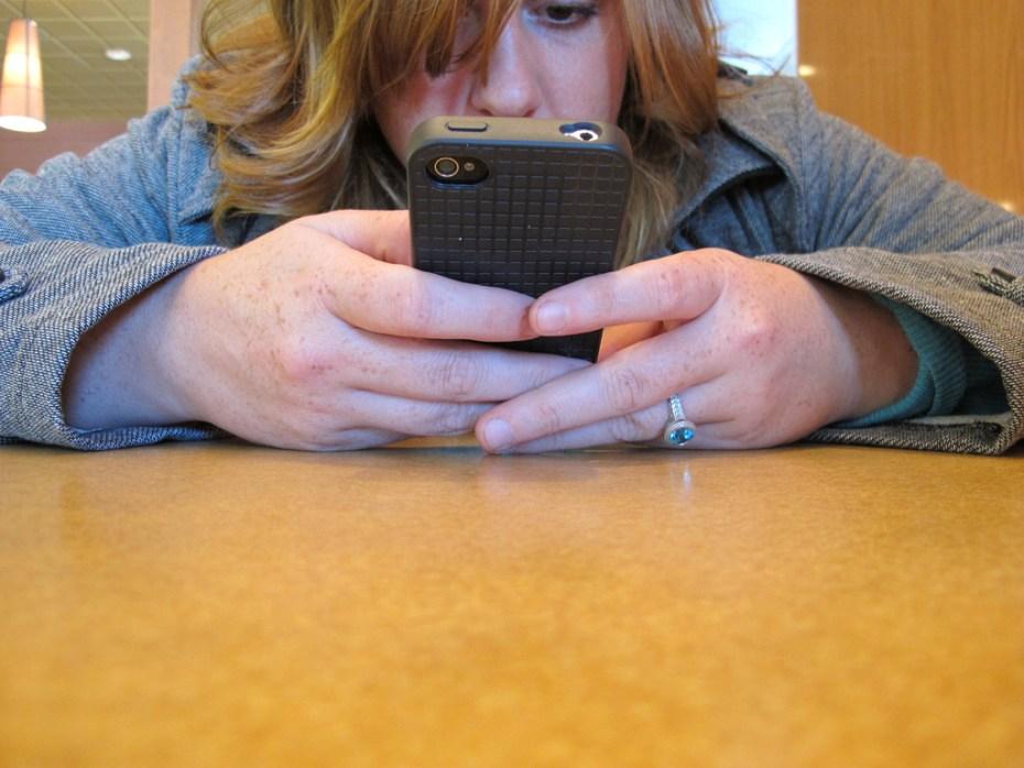 Woman iPhone BuzzFarmers Flickr