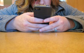 Woman iPhone BuzzFarmers Flickr