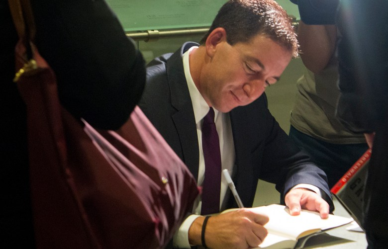 Journalist Glenn Greenwald signs his new book at Cooper Union in New York.