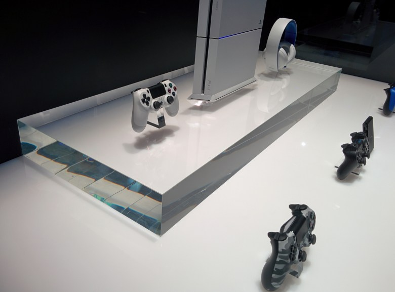 The white PlayStation 4 and DualShock 4.