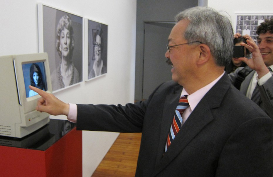 San Francisco Mayor Ed Lee interacts with a technological artifact.