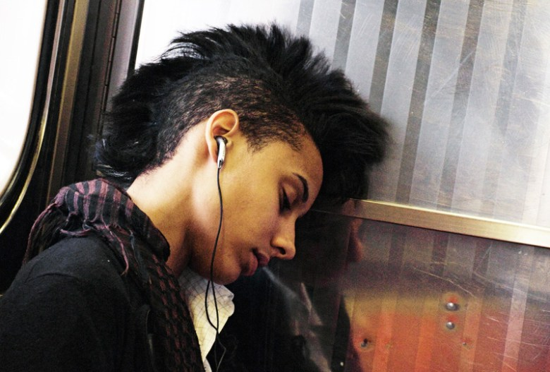 A woman sleeps on the '7' train in Queens, New York.