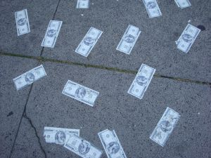 Fake notes glued to the sidewalk promoting Mafia Wars.