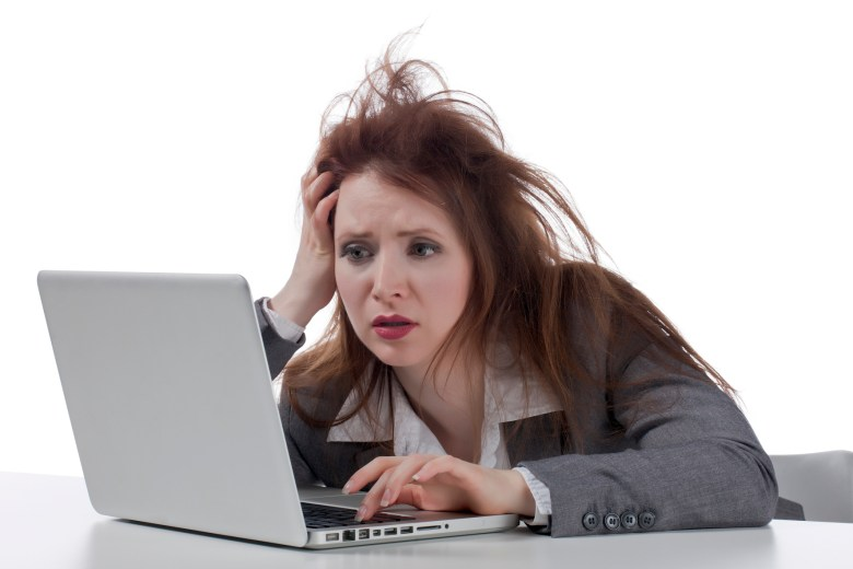 stressed businesswoman with laptop