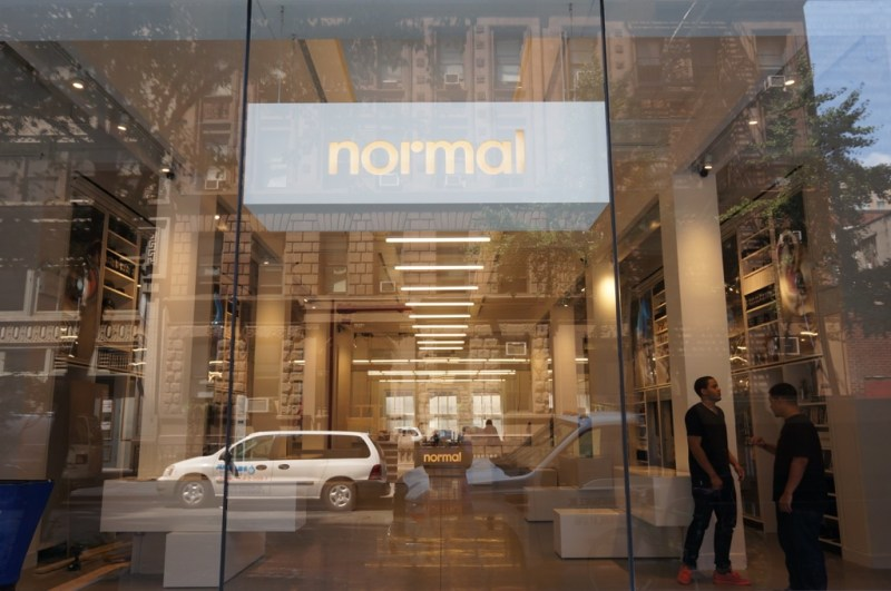 You can see straight through Normal's storefront, all the way to its office staff, from the street.