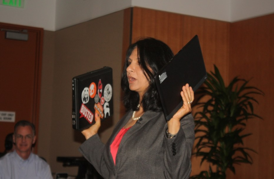Intel's Rani Borkar shows off Broadwell laptop, on right, compared to 2010 laptop on left.