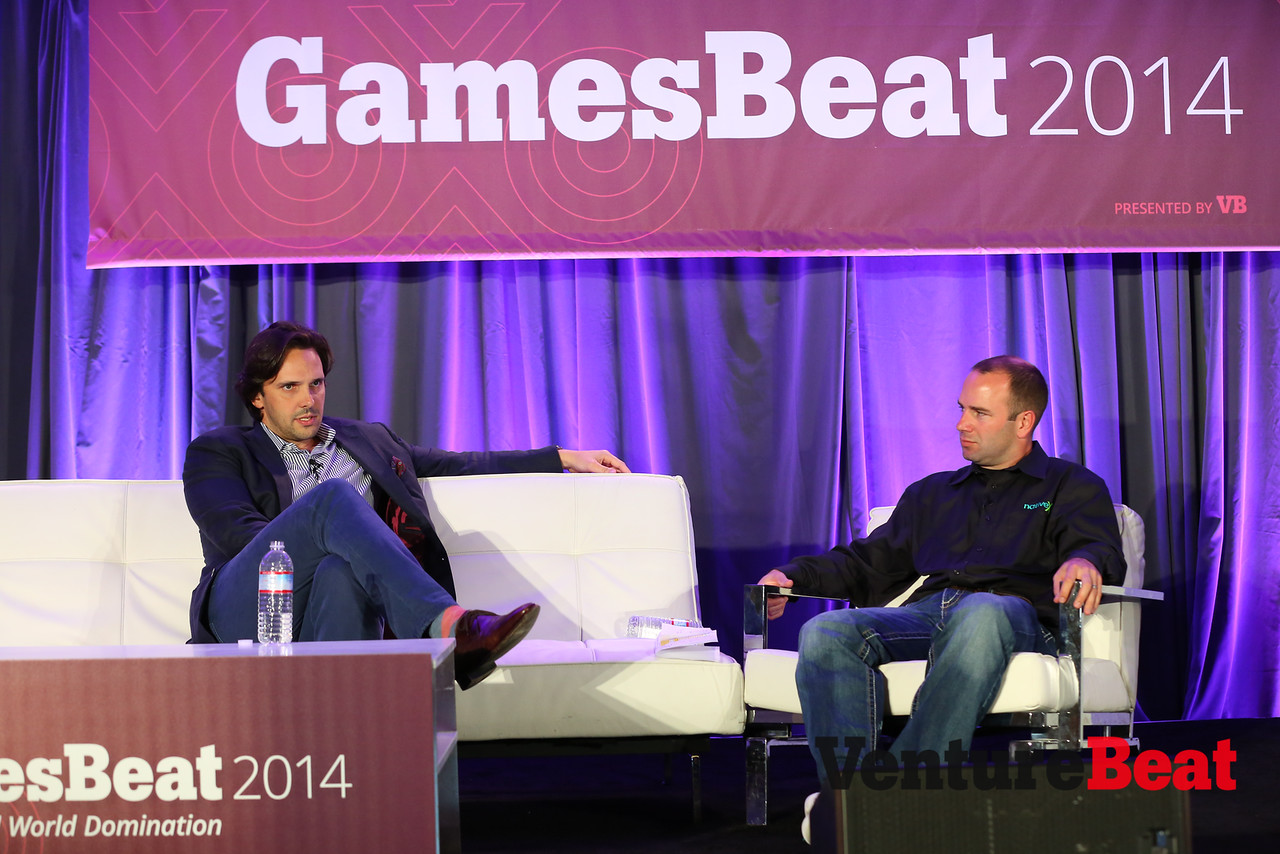 Kixeye chief executive Will Harbin [left] speaks with Rob Weber, senior vice president of business development and a co-founder of NativeX, at the GamesBeat 2014 conference in San Francisco on Sept. 16.