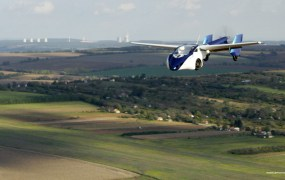 AeroMobil 3 first flight over the horizon countryside.