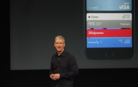 Apple CEO Tim Cook showing off Apple Pay