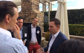 Peter Thiel (c) speaks to venture capitalist Steve Jurvetson and others at Venture Alpha West Tuesday.
