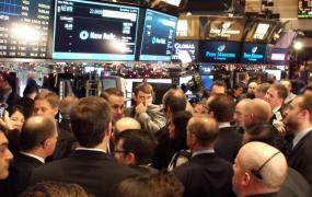 People from the New Relic team stand on the floor at the New York Stock Exchange on Dec. 12, the day the company goes public.