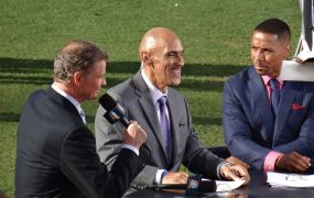 NBC Sports announcers Dan Patrick, Tony Dungy, and Rodney Harrison on the air before a game at Sports Authority Field at Mile High in Denver in September 2013.