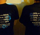 DevOps dudes at a conference, wearing DevOps T-shirts.