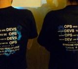 DevOps dudes at a conference, wearing DevOps T-shirts.