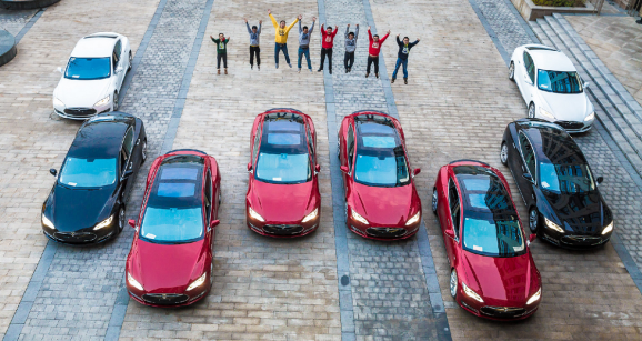These employees are pretty psyched about the Teslas their company just gave them.