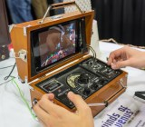 A beautiful old radio box was modified with servos, potentiometers, and an Android tablet to create the Radio Box Controller. It featured a couple of games, including a zeppelin adventure set on Venus. Being able to turn knobs and flip switches to control the zeppelin made for a uniquely tactile experience.