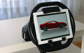 "The Kolos steering wheel holds any 9.7"" iPad, allowing for easier play for racing and tilt games."