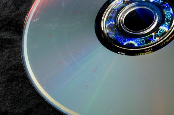 Scratches and gouges allegedly caused by an Xbox 360 disc drive.