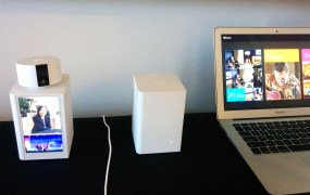 The Lyve Cam (left) automatically uploads photos to a cloud service (shown on the right) as well as storage devices (left and middle).